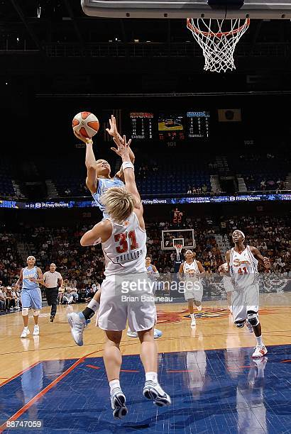 Armintie Price of the Chicago Sky puts up a shot against Erin Phillips of the Connecticut Sun during the WNBA game on June 19 2009 at Mohegan Sun...
