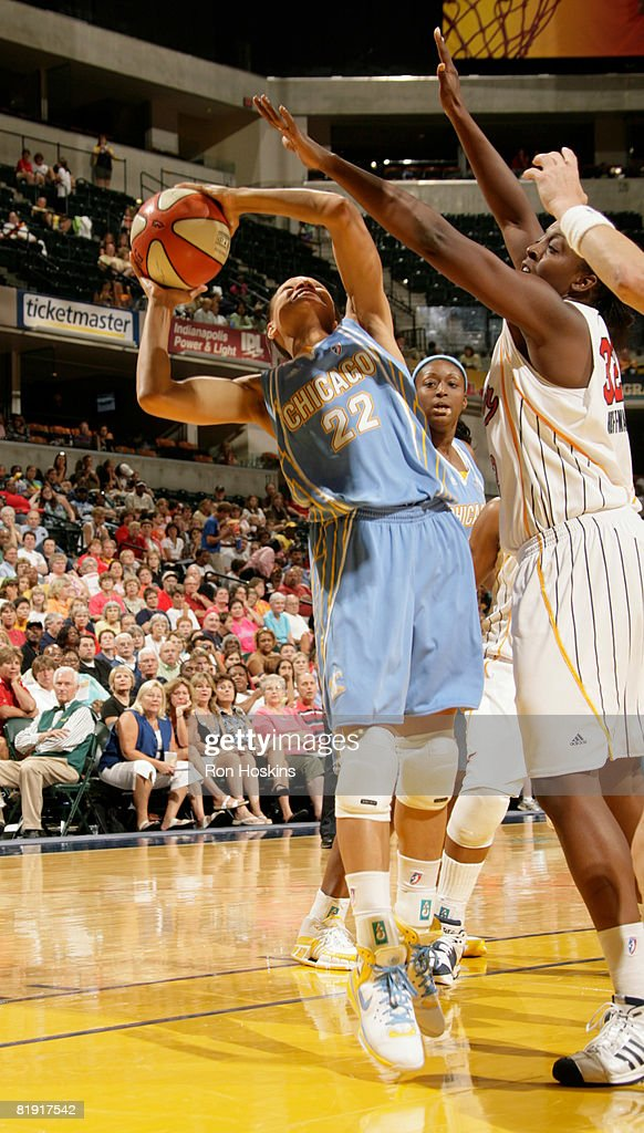 Armintie Price of the Chicago Sky shoots over Ebony Hoffman of the Indiana Fever at Conseco Fieldhouse on July 12 2008 in Indianapolis Indiana The...