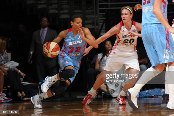 Armintie Price of the Washington Mystics drives against Natalie Novosel of the Atlanta Dream at the Verizon Center on September 14 2012 in Washington...