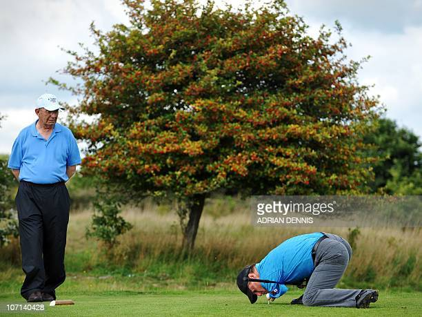 Armless golfer Peter Williams adjusts his ball on the tee during the second day of the Disabled British Open golf tournament at East Sussex National...