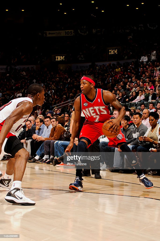 <a gi-track='captionPersonalityLinkClicked' href=/galleries/search?phrase=Armon+Johnson&family=editorial&specificpeople=6530698 ng-click='$event.stopPropagation()'>Armon Johnson</a> #7 of the New Jersey Nets controls the ball against <a gi-track='captionPersonalityLinkClicked' href=/galleries/search?phrase=Ben+Uzoh&family=editorial&specificpeople=4944854 ng-click='$event.stopPropagation()'>Ben Uzoh</a> #18 of the Toronto Raptors on April 26, 2012 at the Air Canada Centre in Toronto, Ontario, Canada.