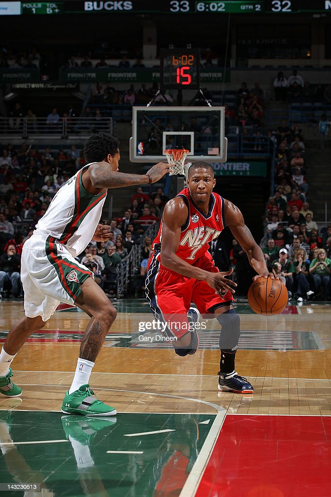 <a gi-track='captionPersonalityLinkClicked' href=/galleries/search?phrase=Armon+Johnson&family=editorial&specificpeople=6530698 ng-click='$event.stopPropagation()'>Armon Johnson</a> #7 of the New Jersey Nets drives to the basket against Brandon Jennings #3 of the Milwaukee Bucks on April 21, 2012 at the Bradley Center in Milwaukee, Wisconsin.