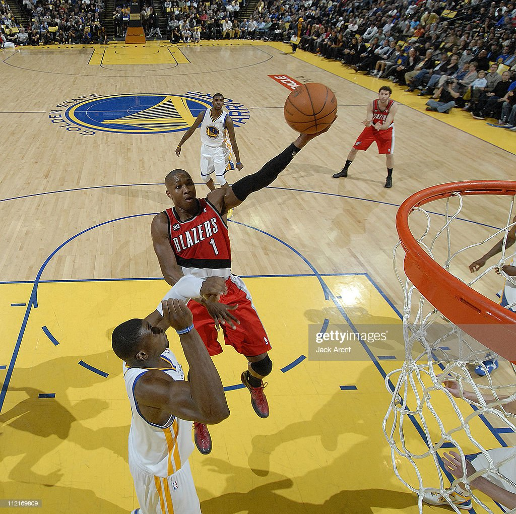 <a gi-track='captionPersonalityLinkClicked' href=/galleries/search?phrase=Armon+Johnson&family=editorial&specificpeople=6530698 ng-click='$event.stopPropagation()'>Armon Johnson</a> #1 of the Portland Trail Blazers scores against the Golden State Warriors on April 13, 2011 at Oracle Arena in Oakland, California.
