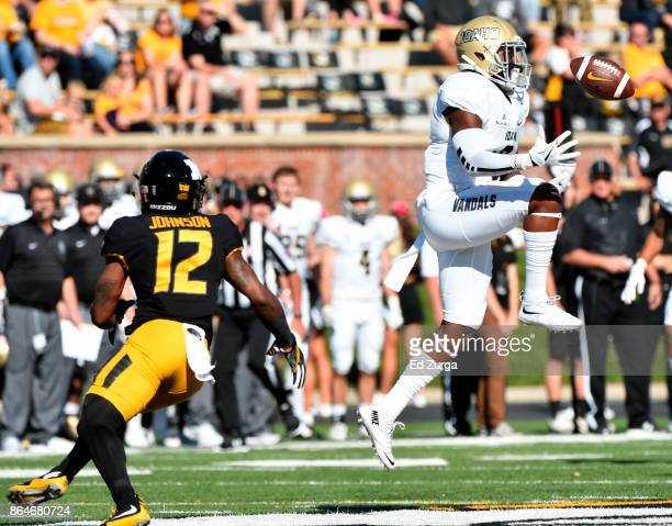 Armond Hawkins of the Idaho Vandals intercepts a pass intended for Johnathon Johnson of the Missouri Tigers in the first quarter at Memorial Stadium...
