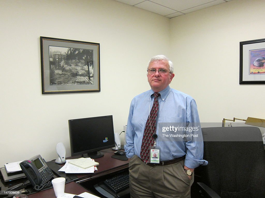 Armond Mascelli, who retires on Friday after 41 years with the American Red Cross, in Washington, DC on June 19, 2012. Armond, of Mount Vernon, was the vice president of disaster operations. In one photo he is in his office, near a photograph of the New England flood of 1956, given to him by a colleague. In the other he is in the Red Cross Disaster Operations Center.