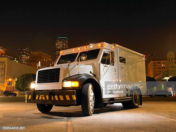 Armored car illuminated by artificial light