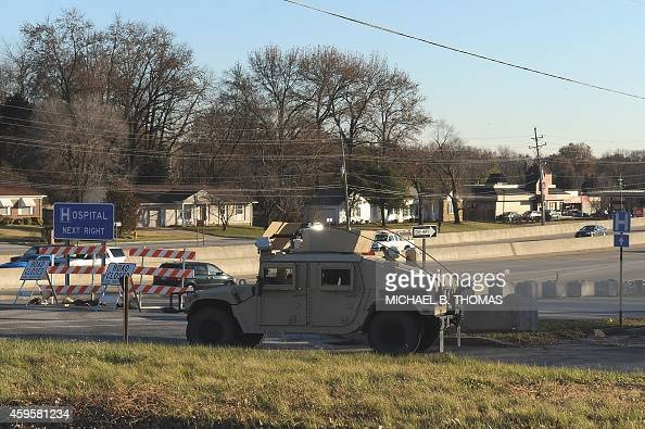 A armored military Humvee of the Missouri National Guard sits at a perimeter blockade in Spanish Lake Missouri on November 25 2104 Protesters set...