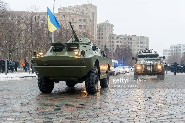 Armored personnel carriers and armored cars of police units and the National Guard of Ukraine ride for the first patrolling in the strengthened mode...