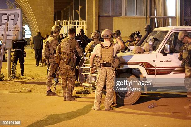 Armored soldiers secure a street outside the Splendid Hotel in Ouagadougou Burkina Faso on 15 January 2016 Several people killed and injured in a...
