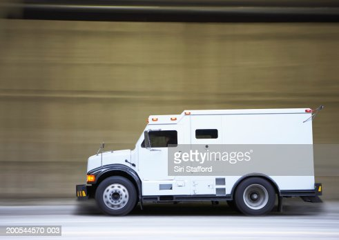 Armored truck on city street