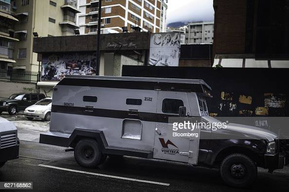 A armored truck used to transport cash moves through a commercial area in Caracas Venezuela on Tuesday Nov 29 2016 In Venezuela the economy is...