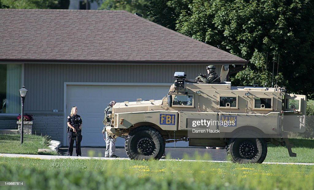 A FBI armored vehicle drives past a home just outside of where swat teams had surrounded the Sikh Temple of Wisconsin where a gunman stormed the mass and opened fire August, 5, 2012 Oak Creek, Wisconsin. At least six people were killed when a shooter opened fire on congregants in the Milwaukee suburb. The shooter who was later shot dead by a police officer.