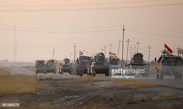 Armored vehicles belong to the Iraqi Kurdish Regional Government's peshmerga forces move to Bashiqa Town from Omer Kamchi village at the Naceran...