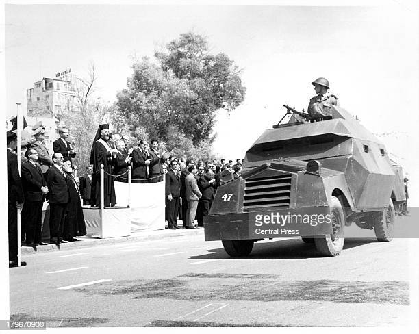 Armored vehicles of the Cyprus Security Forces roles past President Makarios during Eoka Day celebrations in NicosiaCyrus 1964
