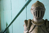 figurine of an armour of knight made in clay bo be use as decoration in garden or houses