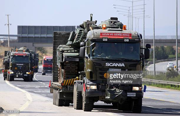 Armoured military vehicles are being delivered on semitrailer trucks to the TurkishSyrian border crossing in southeastern Sanliurfa province of...
