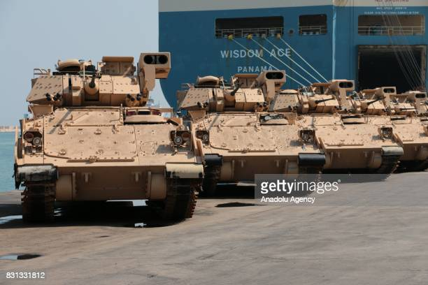 Armoured military vehicles are unloaded from ships at Beirut's port in Lebanon on August 14 2017 8 M2 Bradley Fighting Vehicles with army long...