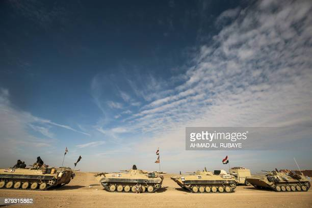 TOPSHOT Armoured personnel carriers of the Iraqi forces and the Hashed alShaabi are seen during the advance through Anbar province 20 kilometres east...