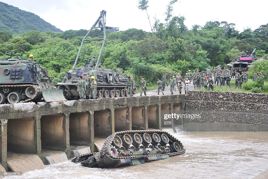 A CM11 armoured vehicle lies upside down in a river killing four of the five soldiers inside in southern Pingtung on August 16 2016 The soldiers were...