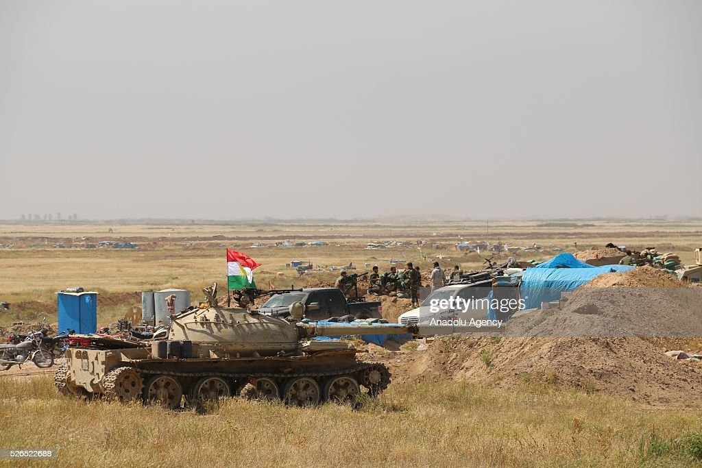 Armoured vehicles belong to Peshmerga forces, attend a joint operation carried out by Peshmerga forces and Shiite Hasdi Sabi forces to rescue Turkmen Besir Village from Daesh in Iraq on April 30, 2016.
