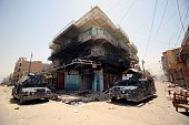 TOPSHOT Armoured vehicles of Iraqi government forces are stationned on a street on June 27 2016 in western Fallujah 50 kilometres from the Iraqi...
