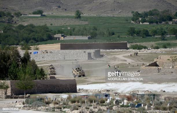 US armoured vehicles patrol as they take part in an ongoing operation against an Islamic State militant stronghold in Achin district of Nangarhar...