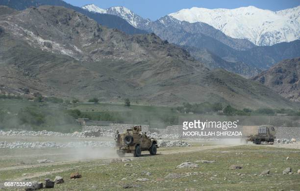 US armoured vehicles patrol near the site of a US bombing during an operation against Islamic State militants in the Achin district of Nangarhar...