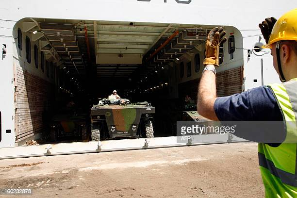 Armoured vehicules part of the French military operation Serval in Mali leave the French military ship and helicopter carrier 'Le Dixmude' on January...