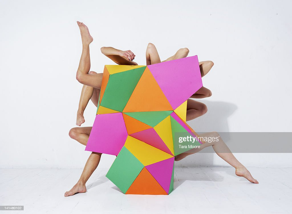 arms and legs emerging from abstract shape : Stock Photo
