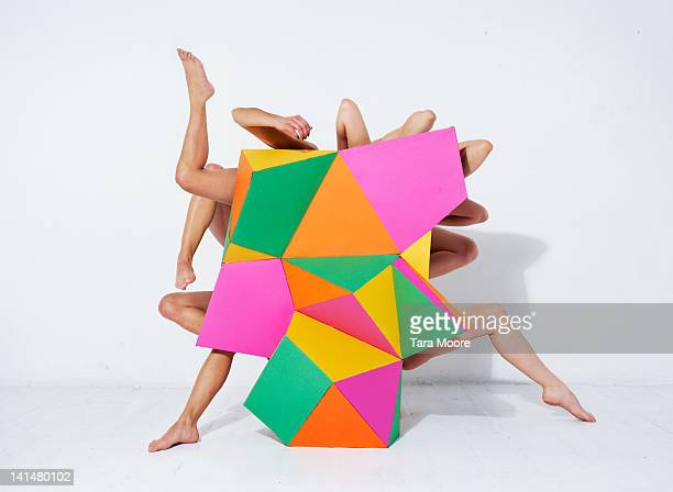 arms and legs emerging from abstract shape