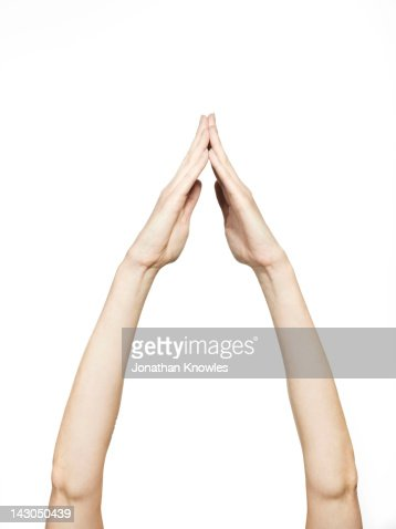 Arms in the air, hands clasped : Stock Photo