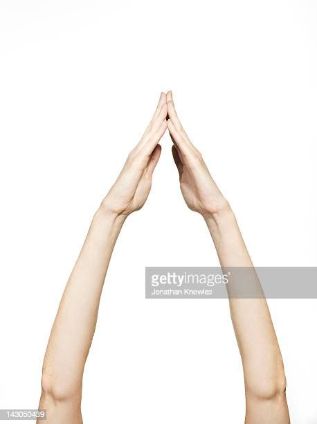 Arms in the air, hands clasped