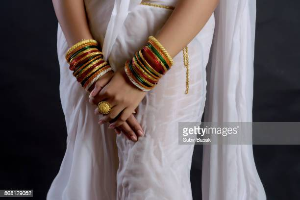 Arms of an Indian woman wearing bangles.