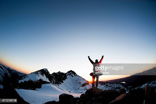 arms raised in the mountains