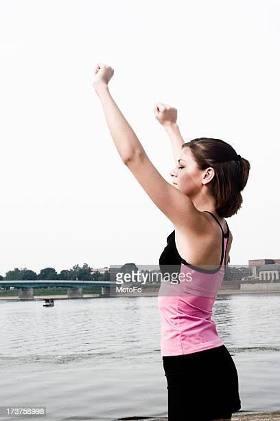 Arms raised praying to the sky