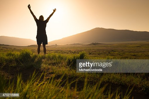 Arms Raised With Smart Phone in Hand