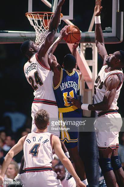 J Armstrong of the Golden State Warriors shoots the ball against Antonio McDyess of the Denver Nuggets circa 1996 at the OaklandAlameda County...