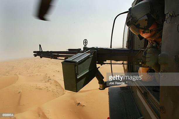 S Army 101st Airborne Sgt Jason Deer from Franklinville New York flies in a Blackhawk helicopter as he mans his M60 Delta machine gun February 16...