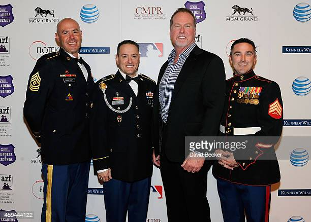 US Army 1st Sgt Garrett Whatcott US Army Cpl Austin Stoker former major league baseball player Mark McGwire and US Marine Sgt TJ Meranda arrive at...