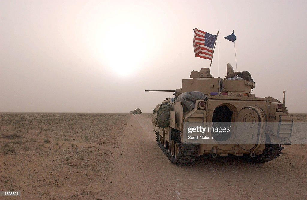 S Army 3rd Division 37 Bradley fighting vehicles take up a position along a road March 19 2003 inside the demilitarized zone between Kuwait and Iraq...