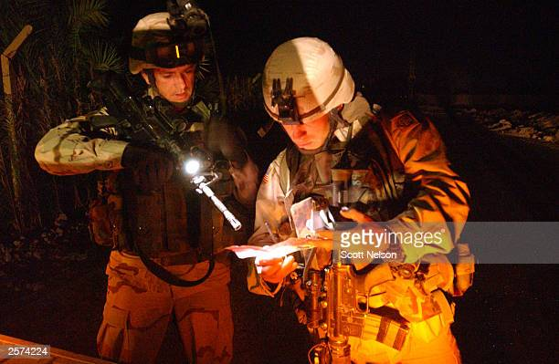 S Army 82nd Airborne Division 1st battalion 504th regiment Staff Sergeant Hall and 2nd Lieutenant Sikora examine a confiscated Iraqi pamphlet by...