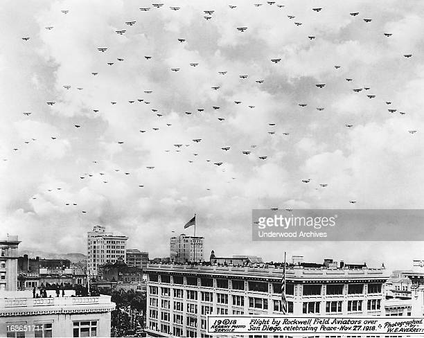 Army Air Corps biplanes from Rockwell Field in Coronado fly over San Diego celebrating peace in WWI San Diego California November 27 1918