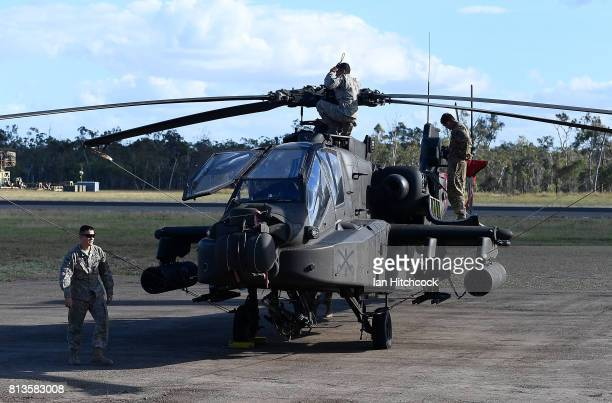 US army Apache attack helicopter is seen sitting at Williamson airfied in the Shoalwater Bay Training Area as part of Battle Group Pegasus on July 12...