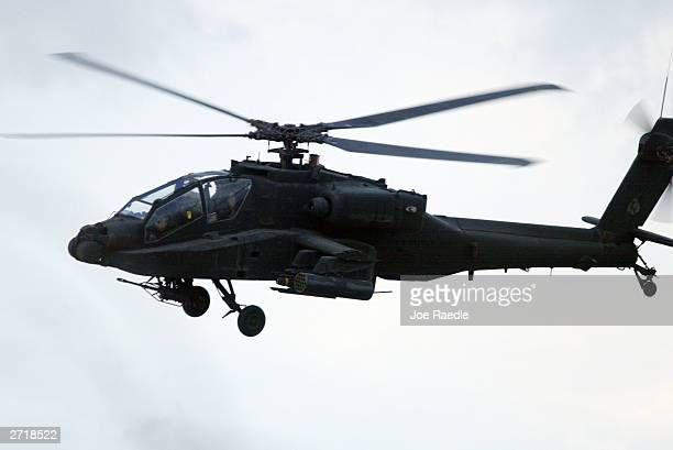 S Army Apache helicopter flies November 11 2003 in Tikrit Iraq With two helicopters shot down in the last two weeks the US Army hopes to capture or...