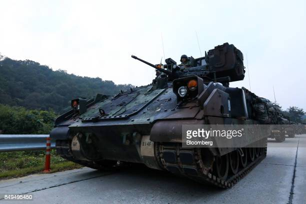 US army armored vehicles travel along a road during Warrior Strike VIII a bilateral training exercise between the US Army's 2nd Armored Brigade...