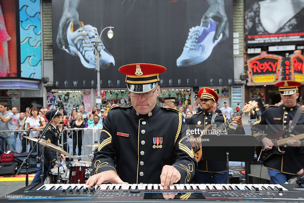 A U.S. Army band plays in Times Square during a ceremony marking the U.S. Army's 237th anniversary on June 14, 2012 in New York City. U.S. Army Chief of Staff Gen. Raymond Odierno swore in 16 new recruits during the celebration.