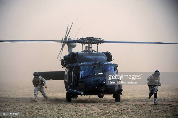 US Army Black Hawk helicopters and personal arrive at the command center near Leadville Colo to support another Army Black Hawk helicopter out of...