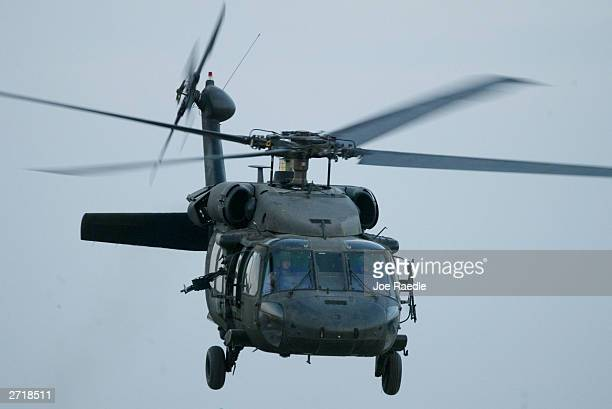 S Army Blackhawk helicopter flies November 11 2003 in Tikrit Iraq With two helicopters shot down in the last two weeks the US Army hopes to capture...