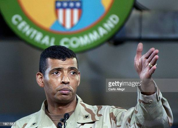 US Army Brigadier General Vincent Brooks points to a reporter to take a question during a briefing at the Coalition Media Center in Camp As Sayliyah...