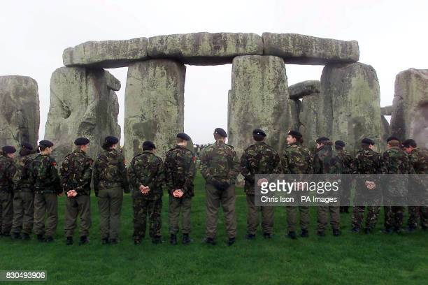Army cadets and members of the Royal British Legion form a circle of rememberance at Stonehenge in Wiltshir Britain fell silent in tribute to the...